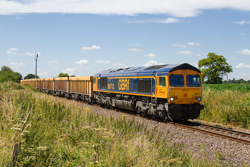 10th Jul 14:  Recently repainted 66713 'Forest City' trots along at Broughton Gifford with 4M50 from Westbury to Stud Farm