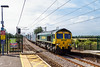 16th Jul 14:  Bang on time as it runs through Manningtree is 66538 heading 4L93 from Lawley Street to Felixstowe.