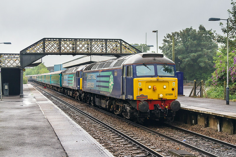 19th Jul 14:  Due to the non availability of the planned Class 68 the 'Catterpillar Cat' from Eastleigh to Crewe was powered by 57009 & 008.  Captured here passing through Warminster