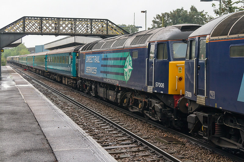 19th Jul 14:  Due to the non availability of the planned Class 68 the 'Catterpillar Cat' from Eastleigh to Crewe was powered by 57009 & 008.  Captured here passing through Warminster. at last my first picture of number 8.!!