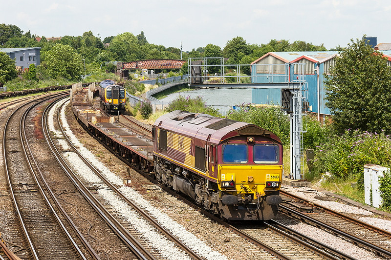 2nd Jul 14:  Empty Car Carriers towed by 66013 are working as 6Z77 from Wembley Eurofreight Centre to Southampton Western Docks.  450557 is in the distance