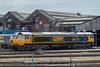 2nt Jul 14:  Just out of the Eastleigh Works  Paint Shop is 66713  'Forest City'.  Tucked behind is 57303