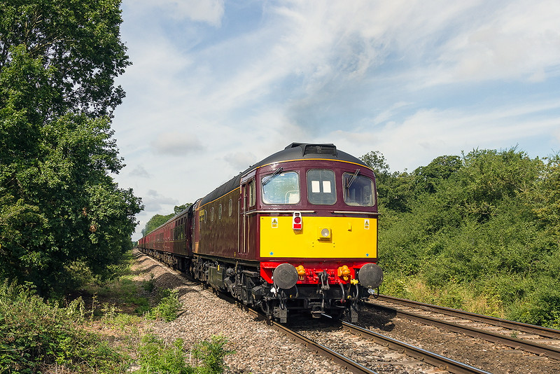 27th Jul 14:  Due to a Fire Risk 33029  is required to relieve the pressure on 5029 up front  is lending a hand by giving a push as the Weymouth Seaside Express accelerates away from Fairwood