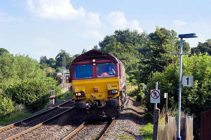 23rd Jul 14:  In beautiful light 66148 heads 6V12 stone empties from Woking to Merehead through Dilton Marsh