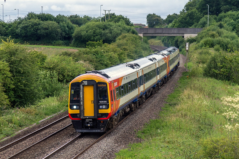 12th Jul 14:  South West Trains 159s are not the usual fare on the main Paddington to the West of England Line.  The 'Long Wey Round' tour from Waterloo to Weymouth went out via the normal LSWR route, however the retuurn,1Z22, went via  The GW to Yeovil, Westbury and gained the Southern again at Salisbury.  159006 and 159020 are  pictured ar berkley between Frome and Westbury