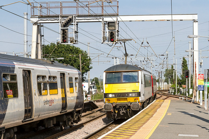 16th Jul 14:  The 15.30 from Norwich to Liverpool Street actually started from Diss . 90014 is passing 321429 which, when the line clears, take the right fork to Harwich
