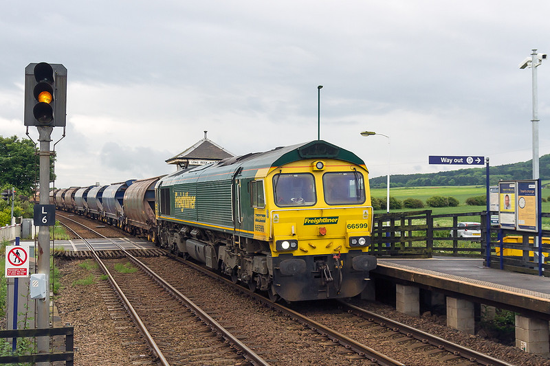 3rd Jun 14:  Running down hill though Long Beck is 66599 on the point of 6F32 from Boulby Mine to Tees Dock
