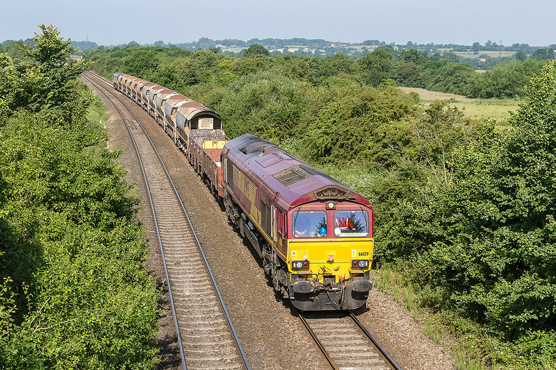 22nd Jun 14:  Running 50 minutes early is 66129 at the helm of 6C04 from Maiden Newton to Westbury.  Colas Rail Freight 66848 was actng a tail gunner, it was suffering from an awful wheel flat