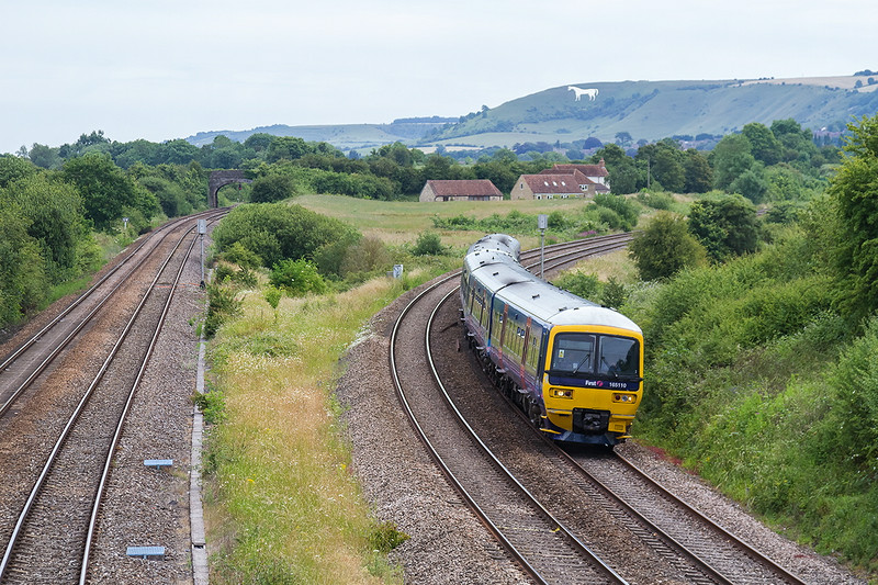 26th Jun 14:  Again the Galstonbury Festival extera the 10.30 from Paddington to Castle Cary, 1Z32,  is programed  to be a Turbo.  Here 165110 is captured on the New Line at Fairwood Junction