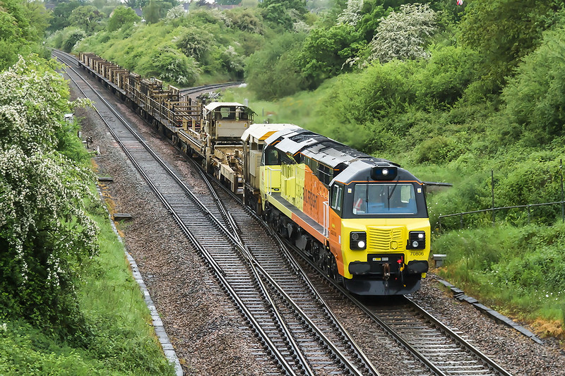 23rd May 14:  With a recovered rail train in tow 70806 is captured at Clink Raoad Junction on a wet and windy Friday morning.  6C99 is working from Long Rock (Penzance) to Westbury