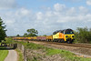 11th May 14:  Running 3 hours late 70806 brings 6C22 from Gaer Junction to Westbury past the White Horsde Business Park at North Bradley