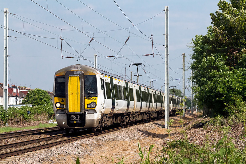 5th  May 14:  Captured from ther Triity Lane crossing in Waltham Cross is 379006 working 2S21 the 10.18 from Bishops Stortford to Stratford
