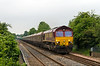 29th May 14:  Storming up the hill through Thurnscoe is66235 with hoppers from Aldwarke to Tees Dock