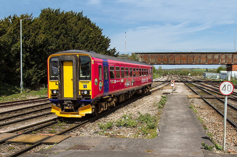 17th Apr 2015:  153325 leaving Westbury with the 14.14 shuttle service to Swindon.  This is the first time that I have seen this new livery and must say thet I preferred the green one that it was in before.