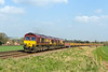 7th Apr 2015:  Running through Bapton are 66136 and 66065 on the point of 6V41 the afternoon Departmental, compising a good rake of JNA & MLA wagons, back to Westbury fron Eastleigh