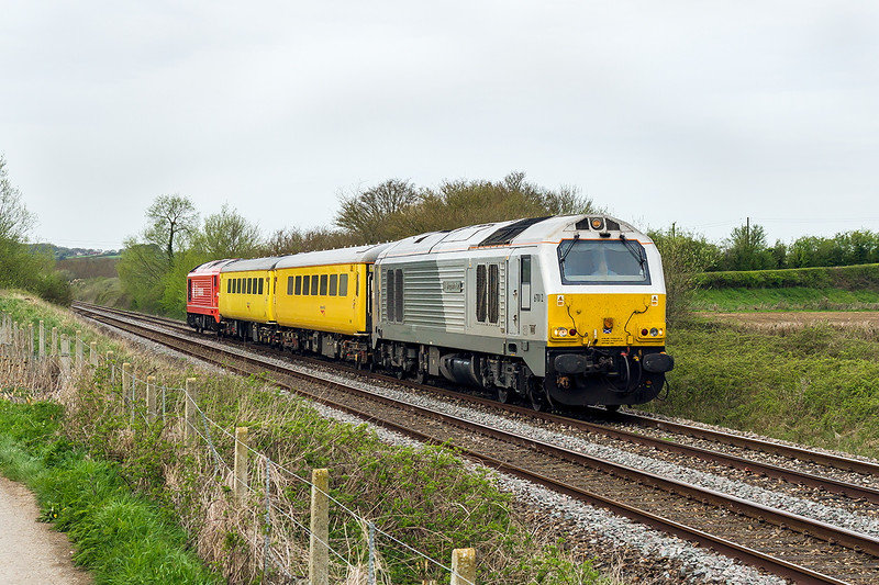 17th Apr 2015:  1Q18 from Paddington to Paddington with 67016 'A Shropshire Lad. on the front gallops  up thWestbury 'Cut Off. between Fairwood and Heywood Road Junctions on a very dull morning.  Standing out on the rear is 67018