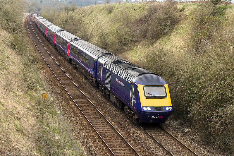 5th Apr 2015:  Despite the look 43031 TnT 43015 are climbing the 1 in 75 to Upton Scudamore with 1O39 the 11.01 from Penzance to Waterloo. With Reading closed over Easter for engineering works West of England services are being based on Waterloo