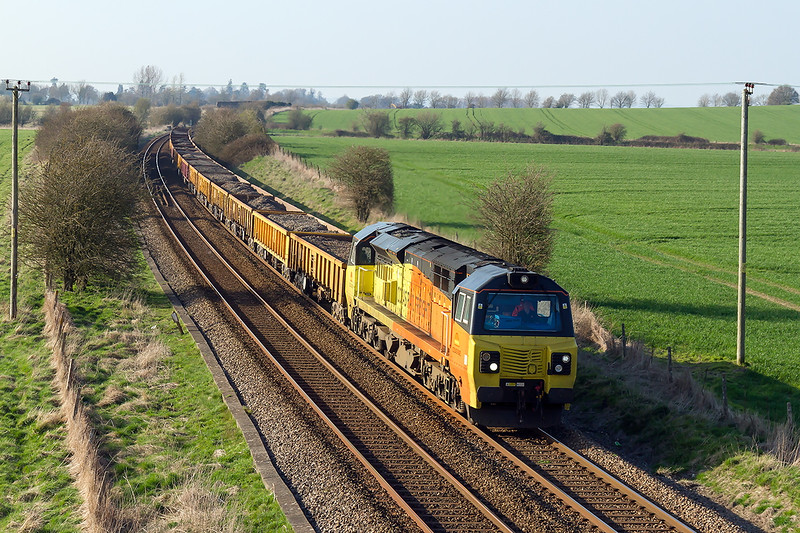7th Apr 2015:  The fact that there is no number on the front tells that this is 70802 albeit a very grubby 70802.  Pictured fron the Granada bridge on the Warminster Byepass this is the evening 6O31 departmental from Westbury to Eastleigh.