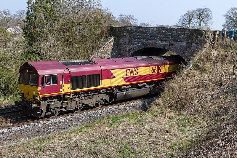 9th Apr 2015:  Looking rather like a posed model rather than the real thing 66119 under the bridge at Sherrington .  It was at the head of 4M52 empty car carriers fron Southampton Eastern Docks to Castle Bromwich and was running at normal line spead.  Ken Harris and Tom Curtis can be seen on the bridge