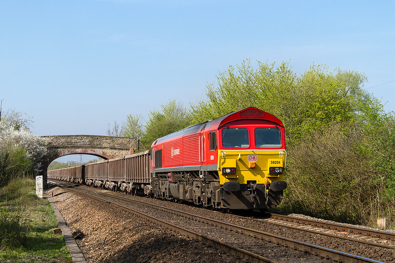 20th Apr 2015:  59204 with a good rake o e mpty  KEAs from Appleford Sidings to Whatley Quarry. The  road over the  bridge isi Dursley Road to the left and Church Road to the right