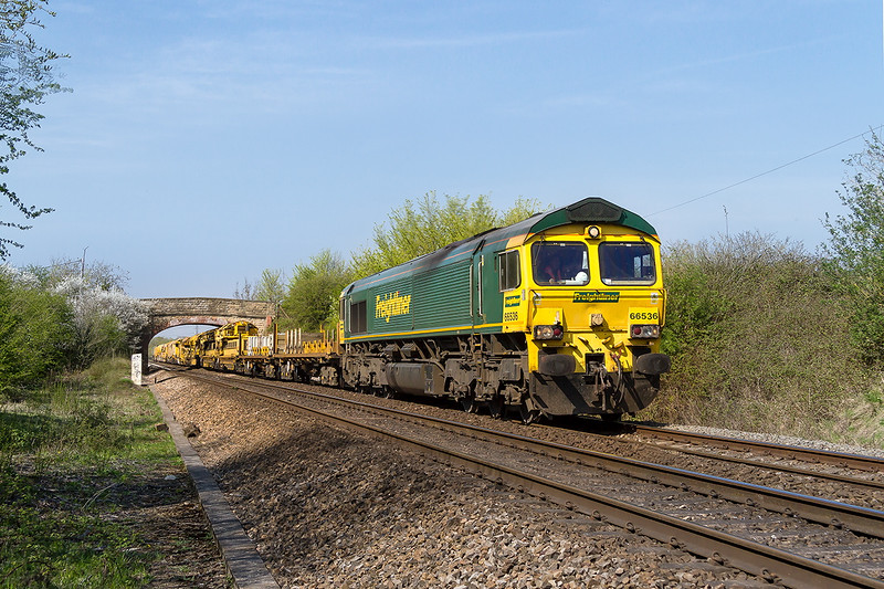 20th Apr 2015:  Running under the Dursley Roaqd brisge in Heywood is 66536 TnT 66507 on 6X04 from Wembley Eurofreight Centre to Fairwater Yard  The load is business part of the Track Relaying Train