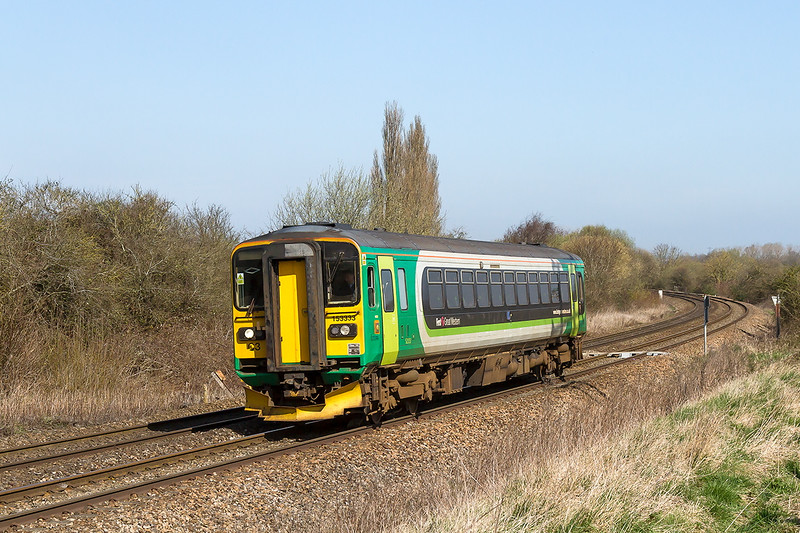 6th Apr 2015:  Oh Poo!  Carefully framed to omit the power lines I totally forgot the shadow of the pylon.  153333 at Hawkeridge with 1M07 the 11.47 Swindon to Westbury shuttle