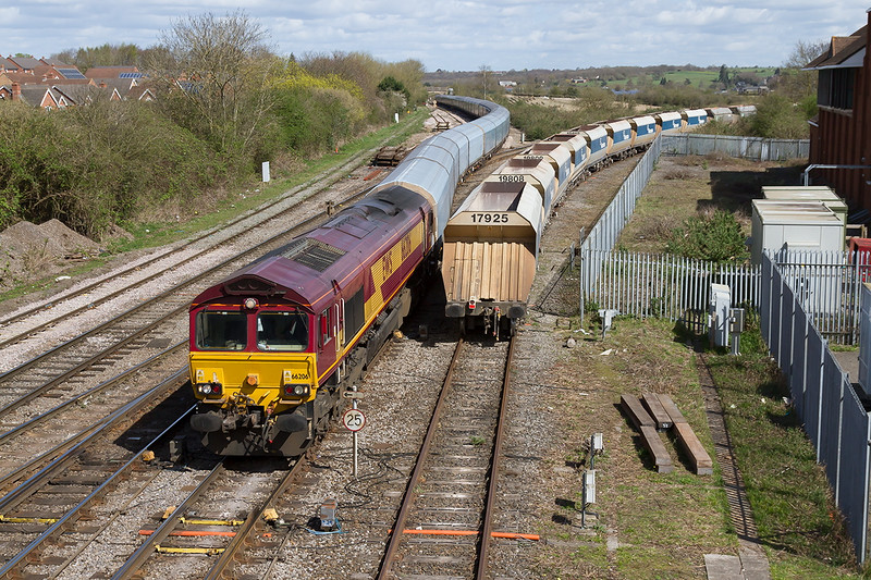 11th Apr 2015:  The long 'Blue Worm' full of Minis stretches bck to Hawkeridge Junction,  66026 heads 4O40 from Morris Cowley to Southampton Eastern Docks