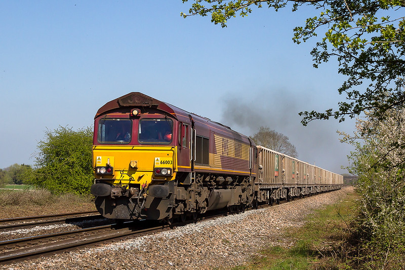 23rd Apr 2015:  Following a  swift reversal at Westbury 66003 brings 7V07 the empties from Chichester over the farm crossing at Fairwood as it heads for Merehead
