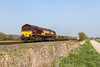 9th Apr 2015:  The Eastleigh to Didcot running as 6V38 passing through Bapton with driver Steve Rogers in the chair.  A long train and well loaded but all the empty wagons were on the front unfortunately