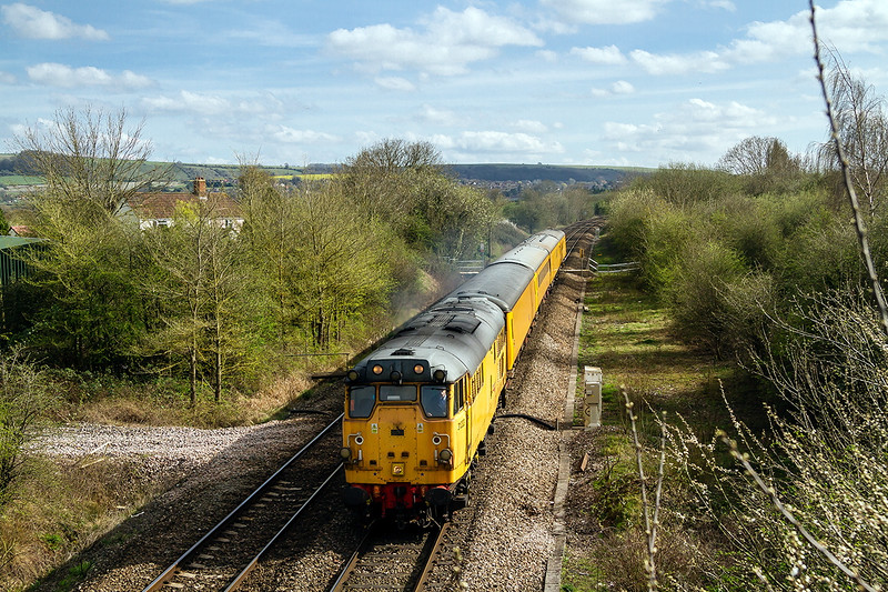 13th Apr 2015:  Running through Heywood is 31233 working 3Z01.  The test train  started from Exeter Riverside NY aqnd is going to Didcot TC.  A picture never to be forgotten as with the train in view a Bumble Bee decided to become entangled in the arm of my glasses and deposited it's sting in my temple.  It is b....y painful.