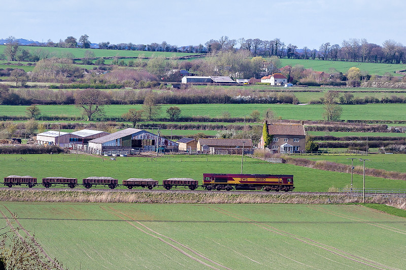 11th Apr 2015:  66082 leads on 6W02 the 16.13 departmental from Westbury to Slough.  Pictured passing Horse Croft Farm next to the Westbury Cement Works from the B3098