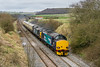 2nd Apr 2015:  DRS 37s 37218 & 37607 scoot through Norton Bavant with only three coaches travelling from Crewe to Eastleigh.  5Z67 had a full rake at the start  but a problem required that the majority were left at Hereford. The stock is required for the Saturday  trip to Aberdeen and then a tour round Scotland.