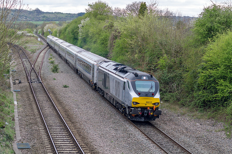 22nd Apr 2015:  Cruising down the hill from Saundrton into Princes Risborough is 68012 heading 1R55 the  16.47 Marylebone to Birmingham Moor Street