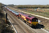 8th Apr 2015:   At Hay Lane near Swindon 66168 is heading a fully loaded 6M66 from Southampton to Garston.  Diverted via the Wylye Valley and Swindon because the slow lines are closed between Didcot and Reading.  The failed pile drive is obvious but there were another 6 in view from this spo !.  Oh what a total waste of money this whole project is.