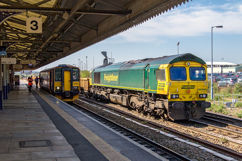 20th Apr 2015:  66596 is shunting back into the yard with thr 10.40 from Fairwater Yard.  In the platform 153305 has the off for 2M08 the 11.47 to Swindon