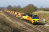 8th Apr 2015:  With Ashbury Crossing in the background 70803 hurries 6M50 from Westbury to Bescot through Compton Beauchamp.