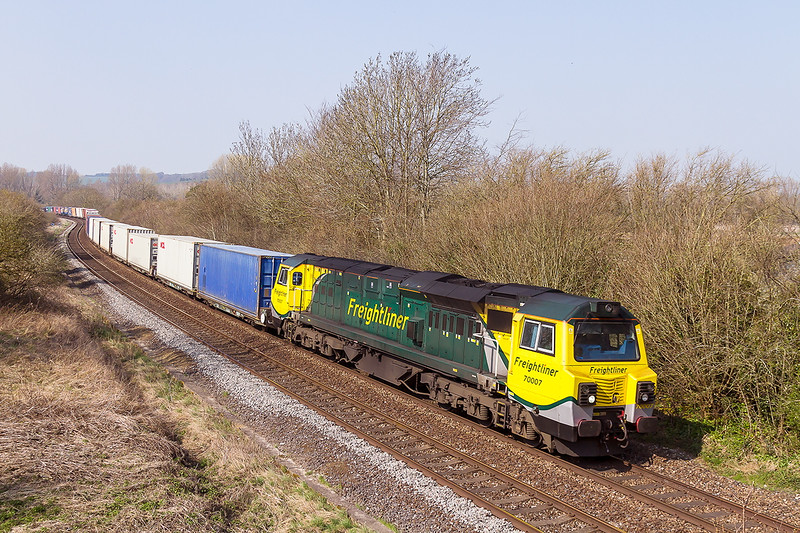 9th Apr 2015:  The Leeds to Southhampton service 4O54 with 70009 at the helm is runnining 20 minutes late as it negotiates the 'S' bend at Sherringtonm