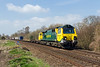 7th Apr 2015:  70009 working from Wentloog on 4O51 to Southampton is diverted to ose the Wylye Valley route and on though Salisbury.  This is taken from the Sherrington Lane crossing.  It is hard too believe that there was once Up and Down loops starting/ending where the loco is.