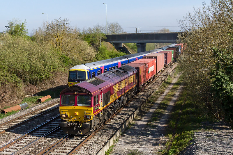 22nd Apr 2015:  4O43 the 06.34 Intermodal from Birch Coppice to Southampton clatters over the junction at Didcot North powered by 66050 'EWS Energy'