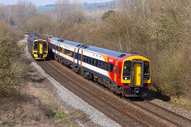 9th Apr 2015:  158101 on the 12.51 from Bristol Temple Meads to Waterloo and 158951 on the 12.23 Portsmouth Harbour to Cardiff pass at Sherrington