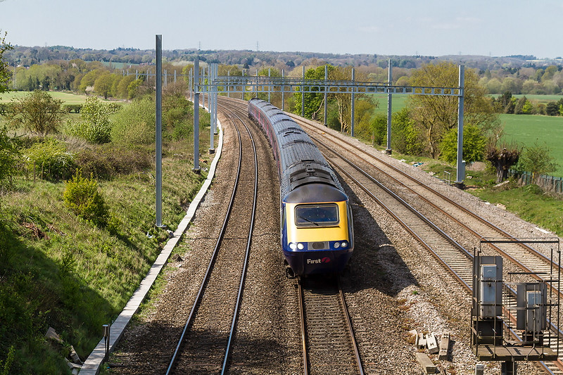 22nd Apr 2014:  Looking west at Westbury Lane in Purley on Thames at the 11.55 from Cardiff approaches.  This view wi be lost when the work to  raiise the bridge parapets are completed
