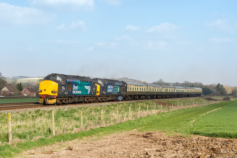 7th Apr 2015:  Returning empty stock fron the Highland Chieftain tour to Crewe from Eastleigh are 37218 & 37607. Captured in some fortunate partial sun light at Bapton as the clouds were building.