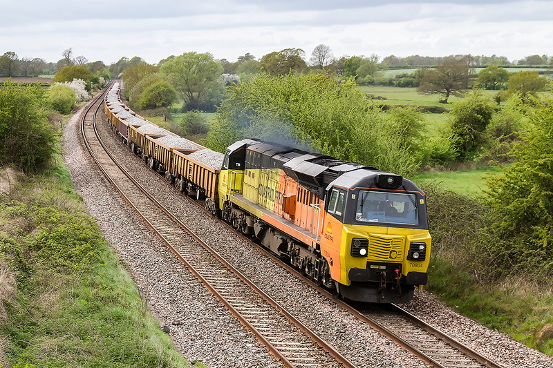 25th Apr 2015:  Making a good noise as climbs through Great Cheverell is 70804 tasked with 6C26 from Westbury to Didcot TC