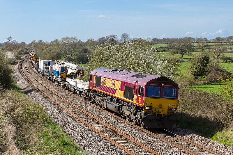 11th Apr 2015:  6X03 from Westbury to Slough is worked by 66140 as it runs 12 minutes early through Great Cheverell.  The load cosits of a crane, point carriers, ballast and a couple of empties at the rear