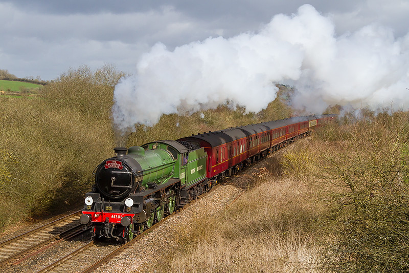 1st Apr 2015:  Possibly 'The Cathedrals Expres's brings an LNER Class B1  for the first time to the Wilts, Somerset and Weymouth line.  61306 'Mayflower, is working well as it passes Strap Lane between Witham  Friary and Bruton.  1Z30 was running from Oxford via the Berks & Hants to Kingswear.