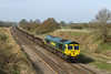 8th Apr 2015:  4L31, with 10 empty 'Pocket Containers' on the front,  in the hands of 66955 is pictured at Compton Beauchamp is working from Bristol Freightliner Terminal to Felixstowe FLT