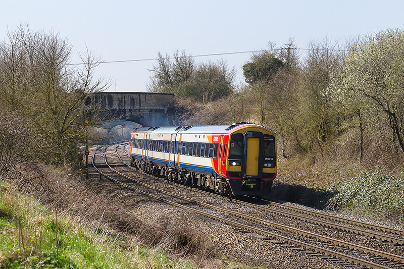 6th Apr 2015:  159016 working 1V22 the 10.52 Salisbury to Bristol Temple Meads passes under 'Shallow Wagon Lane' bridge at Hawkeridge Junction