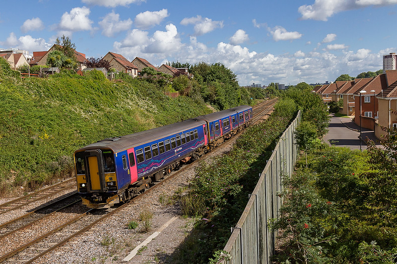 28th Aug 2015:  Where ther was once eleven line now only three remain as the houses now stand on  ground that was Malago Vale Carriage sidings. 153380 is working 2Y14 the 11.12 Bristol Parkway to Weston Super Mare service