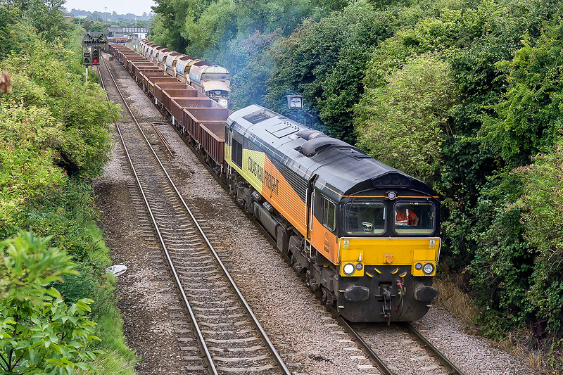 5th Aug 2015:  At last I have a shot of one of the Departmental services involved in the track lowering work under the Dundas Aquaduct at Claverton on the Avon Valley line.  This is 6C63 from Westbury with a monster load of MLA 4 wheelers.  At the rear just visible way beyond the distant road bridge is 70807 neaded for the return journey