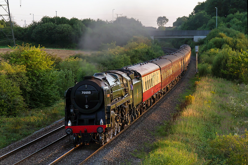 8th Aug 2015:  In nearly the last of the light and really going well 70000 'Britannia' races through Berkley Marsh on 1Z71 the return leg of the West Somerset Steam Express from Minehead to Paddington